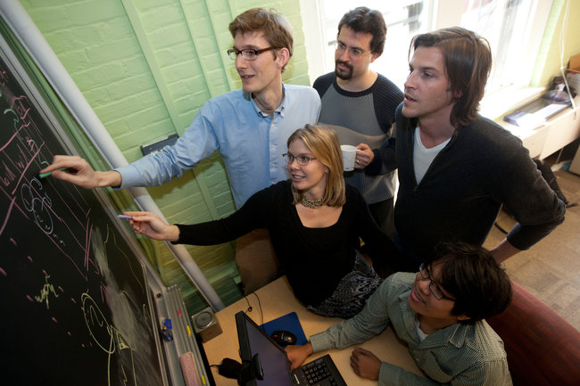 At Harvard, Erez Lieberman Aiden and Jean-Baptiste Michel, standing center and right, are among those working on a browser to note changes in language over time. Credit Kris Snibbe/Harvard University.